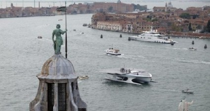 The Turanor PlanetSolar, the world's largest solar-powered boat, travels on the Venetian Lagoon in Venice