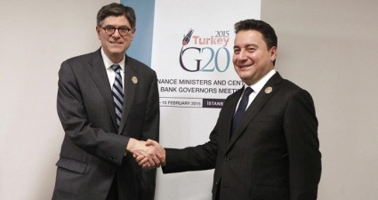 Turkish Deputy Prime Minister Babacan and U.S. Treasury Secretary Lew shake hands during G20 finance ministers and central bank governors meeting in Istanbul