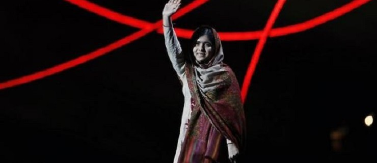 Nobel Peace Prize laureate Yousafzai waves as she arrives on stage at the Nobel Peace Prize Concert in Oslo